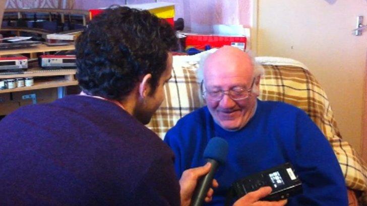 Stan Beaton listens to recording