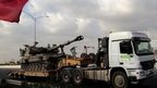 An Israeli army artillery canon transported towards the north on a main Israeli highway as it passes near Hadera.