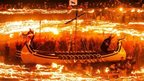 Members of the Jarl Squad dressed in Viking costumes and holding flaming torches during the Up Helly Aa Viking festival, in Lerwick on the Shetland Isles