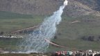 Smoke rises from shells fired from Israel over al-Wazzani area in southern Lebanon
