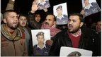 Relatives of Islamic State captive Jordanian pilot Moaz al-Kasasbeh protest outside the PM building in Amman, Jordan (27 Jan 2015)
