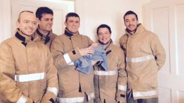 Fire crew with baby