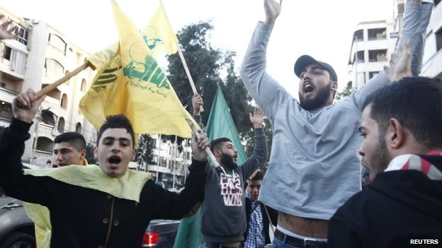 Hezbollah supporters in Beirut celebrate after hearing news of the attack on the Israeli military convoy (28 January 2015)