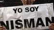 "A man holds up a sign that reads ""I am Nisman"" in Buenos Aires on 22 January, 2015."