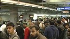 Passengers waiting as Delhi metro train arrives at station platform