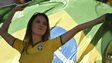 A Brazilian fan waves her national flag at the 2014 World Cup