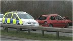 The crashed car and a police vehicle on the A33 in Reading