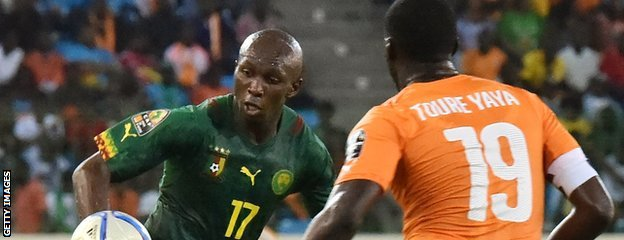 Cameroon's Stephane Mbia and Yaya Toure of Ivory Coast