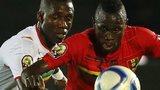 Mali's Modibo Maiga challenges Guinea's Issiaga Sylla