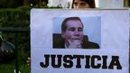 Woman holds placard of Alberto Nisman at protest in Buenos Aires. 27 Jan 2015