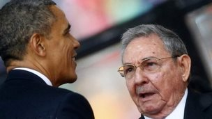 Obama and Castro at Mandela's funeral, 10 December 2013