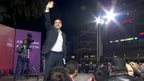 Alexis Tsipras waving to supporters
