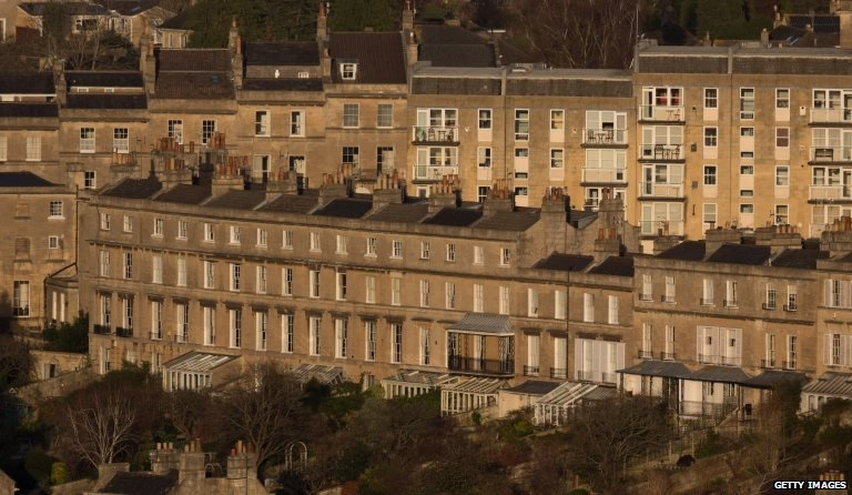 The sun illuminates property in the historic city centre of Bath