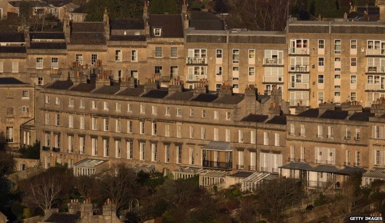 The sun illuminates property in the historic city centre of Bath