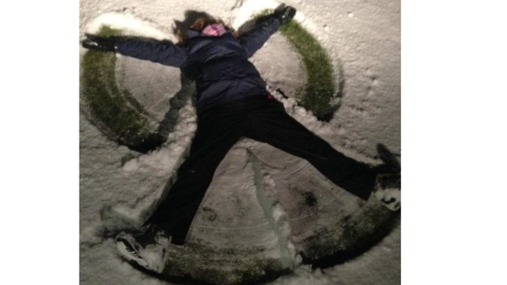 Laura Bicker making a snow angel