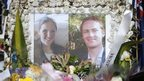 Photographs of Katrina Dawson and Tori Johnson are displayed in a floral tribute near the site of the siege in Sydney's Martin Place, 23 December 2014.