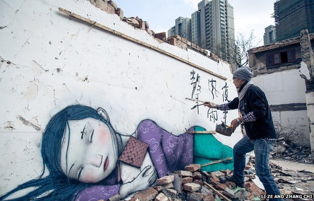 Chinese artist Shi Zheng Paintings by Shi Zheng (R) began appearing on Shanghai walls last month