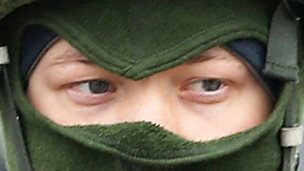 Soldier in green balaclava