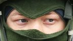 Soldier in green balaclava