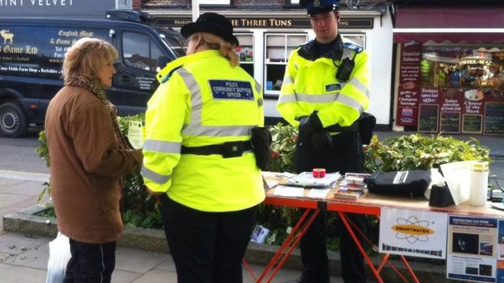 Police officers at a stall