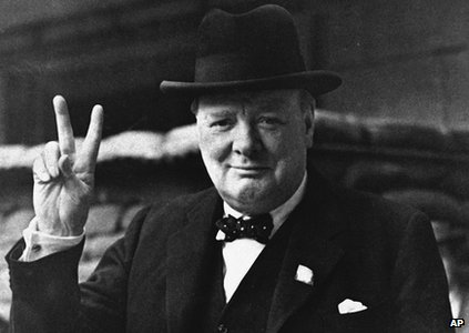 Winston Churchill gives his famous V for Victory salute
