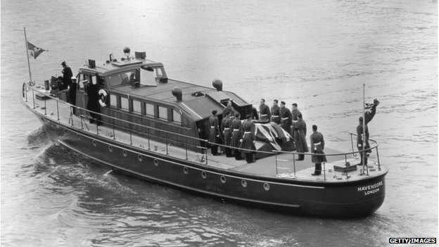 The Havengore carrying Sir Winston Churchill's coffiin along the Thames