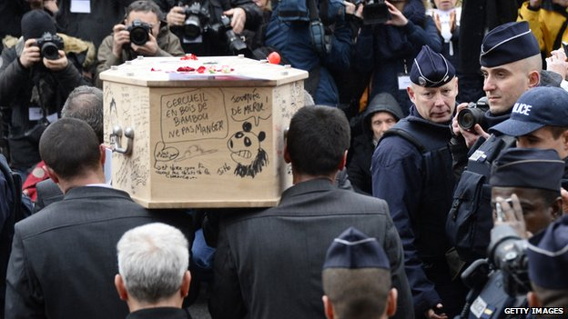 The coffin of Bernard 'Tignous' Verlhac, 57, one of the French satirical weekly Charlie Hebdo's cartoonists, is carried outside the town hall of Montreuil, near Paris during his funeral on 15 January 2015