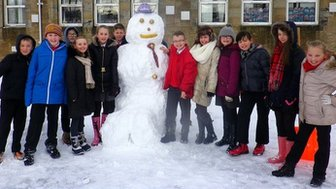 Snowman with schoolchildren