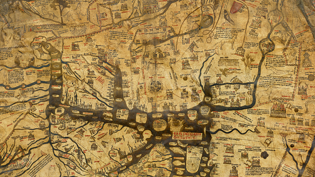 Mappa Mundi. The world depicted is centred on Jerusalem.  The single sheet of vellum features about 500 drawings - including cities and towns, events, plants and animals, plus strange mythical beasts.