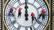 Abseilers clean and inspect the famous Westminster clock-face