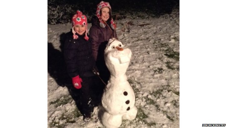 Katie and Emma McKinstry, from Bearsden with Olaf the snowman