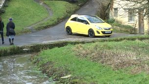 Yellow car in Bibury