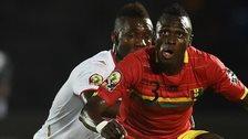 Guinea defender Issiaga Sylla vies with Mali's forward Modibo Maiga