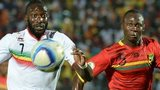 Mali forward Mustapha Yatabare and Guinea defender Fode Camara