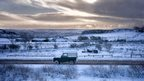 Motorists make their way over Hannahstown Hill on January 29, 2015 in Belfast,