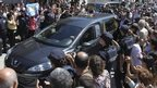 Protesters surround the funeral procession of Argentine prosecutor Alberto Nisman arrives to the Jewish cemetery in La Tablada locality, outskirts of Buenos Aires, Argentina, 29 January 2015