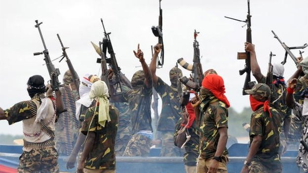 Fighters with the Movement for the Emancipation of the Niger Delta (MEND) raise their riffles to celebrate news of a successful operation by their colleagues against the Nigerian army in the Niger Delta on 17 September 2008