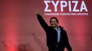 The leader of the Spanish Podemos party Pablo in front of a Syriza banner