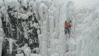 Man climbing frozen Niagara Falls