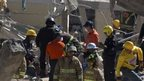 Rescue workers at the scene of the blast
