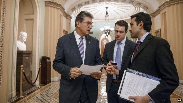 Senator Joe Manchin, D-W.Va., the Democratic co-sponsor of the Keystone XL pipeline bill, left, arrives on Capitol Hill in Washington, 29 January 2015