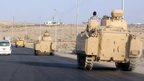Egyptian armoured vehicles head along a road in El-Arish on way to the Rafah. 13 August 2011