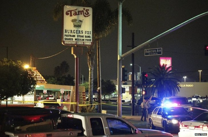 Police stand near the scene in LA where a pedestrian was killed in a hit-and-run crash
