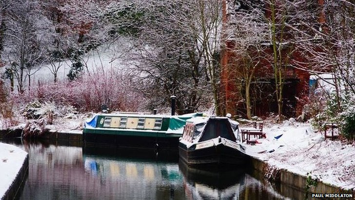 Canal boat with snow on it