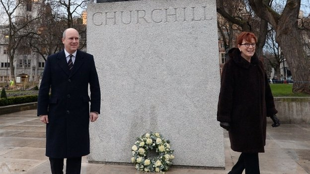Randolph Churchill lays a wreath at the statue of his great-grandfather Sir Winston Churchill in Parliament Square