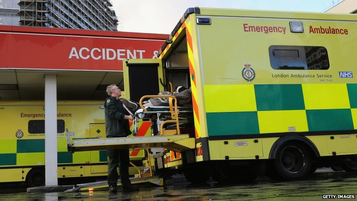 A patient is taken from an ambulance to A&E
