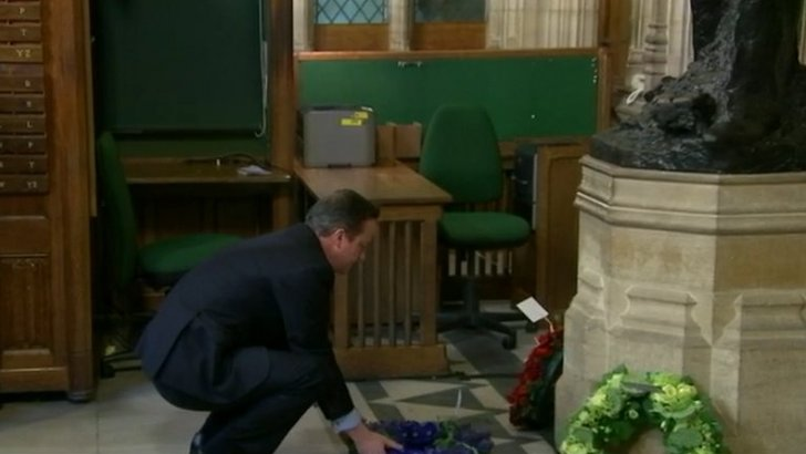 David Cameron lays a wreath at Churchill ceremony