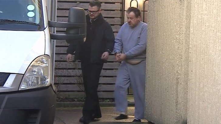 Andrew Main, pictured in grey, led to security van