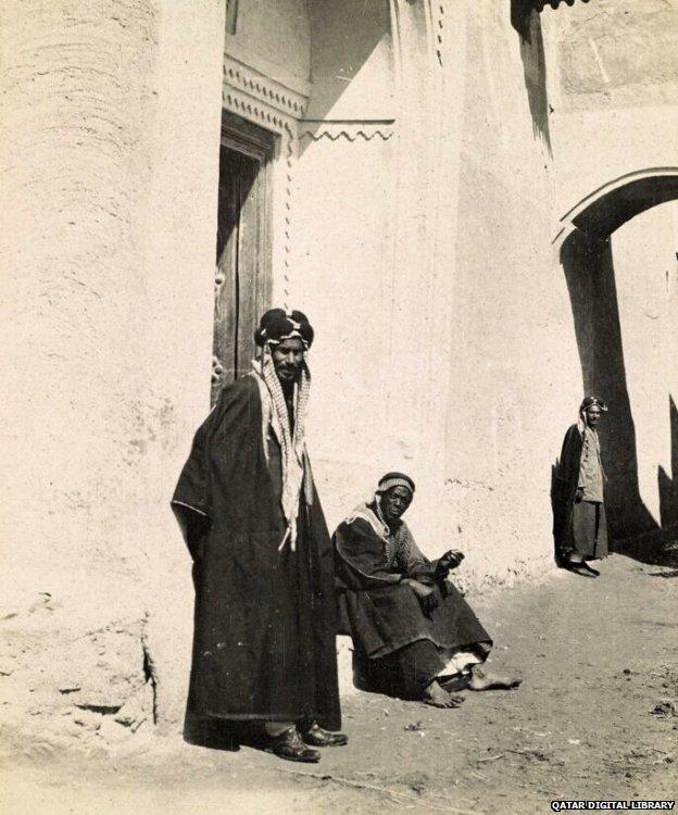 Street scene in Kuwait, shows two men in a doorway, 1918