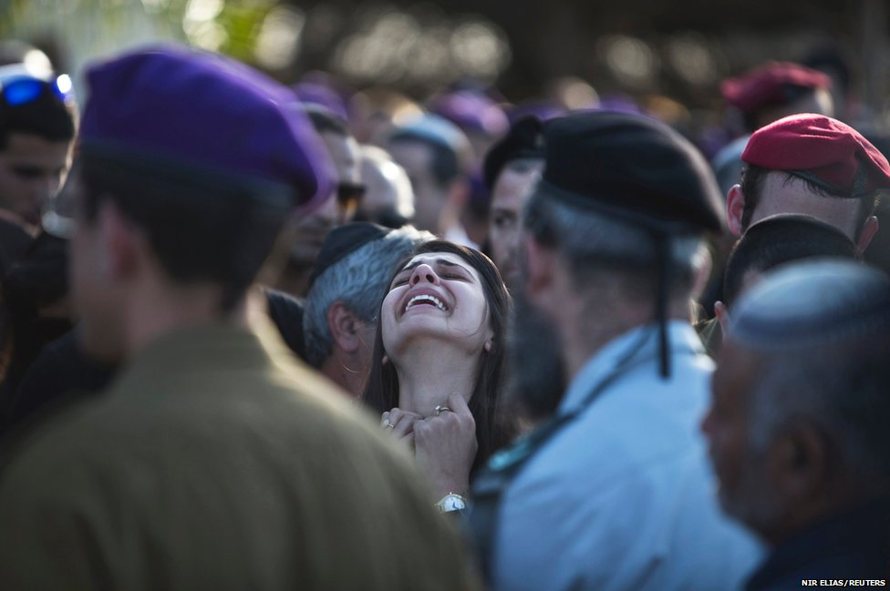 Sahar, the girlfriend of Israeli soldier Dor Nini mourns during his funeral in a cemetery at Shtulim village near Ashdod